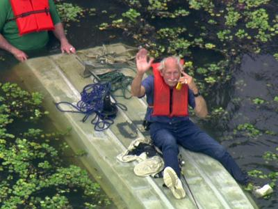 Two men were rescued after their boat capsized in the Shearon Harris Lake in Chatham County on May 4, 2010.