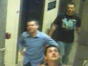 Raleigh police want to identify the men depicted in an image from a security camera in a parking garage on West Cabarrus Street, where vandals emptied a fire extinguisher onto three cars on May 7.