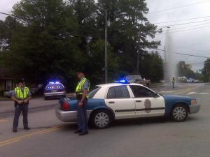 Raleigh police block off Garner Road on May 25, 2010, because a broken main was shooting water into the air.