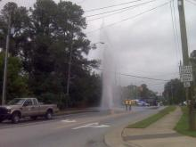Water shoots into the air from a broken water main on Garner Road in Raleigh on May 25, 2010.