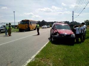 One person was injured in a wreck involving an SUV and a school bus in Wilson County on Tuesday afternoon, the state Highway Patrol said. (Photo by Kevin Raper)