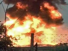 Raw: Lightning sparks gasoline tank farm fire