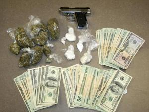 Greenville police searched an apartment on Hooker Road Friday, June 11, 2010, and seized 15 grams of crack cocaine, 30 grams of powder cocaine, 126 grams of marijuana, a stolen .380-caliber handgun and $2,726 in cash. (Photo courtesy of Greenville police)