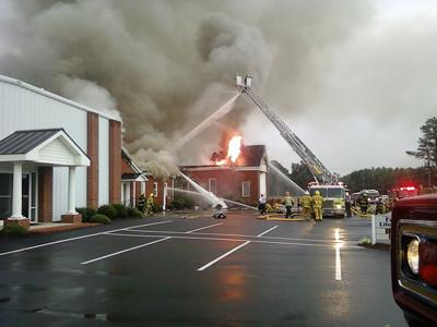 Firefighters battle a fire at Nobles Chapel Baptist Church, at 7330 Old Raleigh Road in Sims, on Sunday, June 13, 2010. (Photo from Kevin Raper)