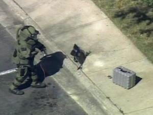 Durham police evacuated an office building and closed roads near the corner of Westgate and University drives Tuesday morning after a suspicious package was found on a curb outside a Taxpayer Service Center of the North Carolina Department of Revenue.
