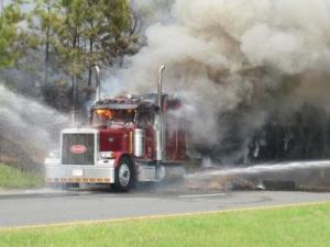 A tractor-trailer caught fire along US-64 near Mt. Gilead Church Road in Pittsboro on July 8, 2010. (Photo by Rickey Spivey)