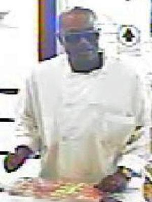 This surveillance photo shows the suspect in the robbery of   Lowes Grove BP, 2317 N.C. 54 in Durham, on June 28, 2010.