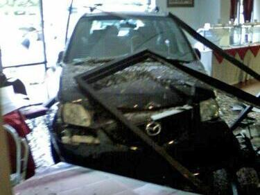 A car crashed into the Chef of India restaurant at 748 Chatham St. in Cary shortly before 2 p.m. Sunday, July 11, 2010, police said. (Photo courtesy of Sabina Wiggins)