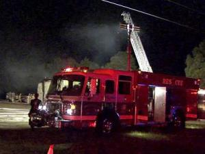 Flames tore through the Nu-2-U Consignment Shop, at 1890 Mallard Road near Smithfield on Aug. 2, 2010.