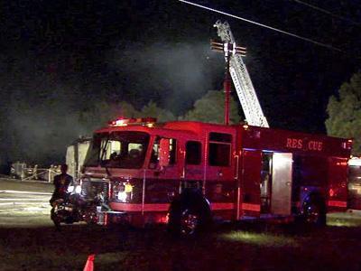 Flames tore through the Nu-2-U Consignment Shop, at 1890 Mallard Road near Smithfield on Aug. 2, 2010.