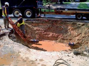 A truck driver backed over a fire hydrant in the parking lot of the Ridgewood Shopping Center, off Wade Avenue at Dixie Trail, Sept. 1, 2010. That opened up a leak that's created a 15-foot wide and six-feet deep hole in Wade Avenue.