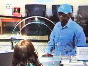 Durham police are trying to identify the man seen in a surveillance image from the Suntrust Bank at 3421 N. Roxboro Road.