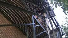 IMAGES: 911 call: Men's bodies on fire escape for hours