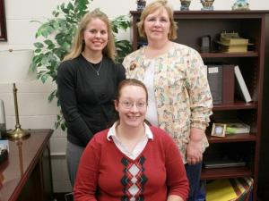 Johnston County Schools recognized guidance counselor Katherine Moynihan (front), PE teacher Tiffany Carroll (back, left) and school nurse Rebecca Anderson (back, right) as November Employees of the Month. The women performed CPR on a student's grandmother who had a heart attack at the school, saving her life. (Photo courtesy of Johnston County Schools)