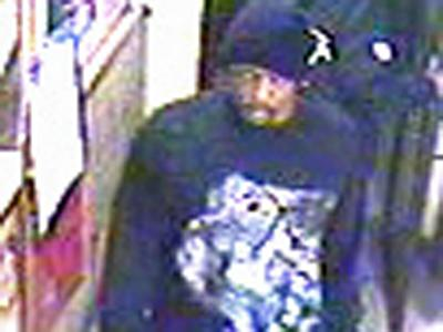 Raleigh police distributed this surveillance image of a suspect in the armed robbery of Old Garner Road Food Mart, 1400 Garner Road.