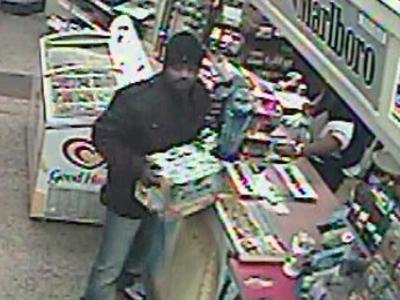 A man wanted in the robbery of a pizza delivery driver in Raleigh is captured Nov. 17 on surveillance video at a Raleigh convenience store.