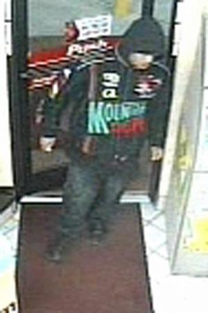 This surveillance photo was taken at a Durham convenience store 30 minutes after a family was robbed at gunpoint in Brier Creek Commons Shopping Center Dec. 14..