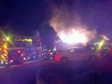 A fire tore through a building on Grinding Stone Drive in the Walden Woods Condominiums complex, off East Millbrook Road, early Wednesday, Dec. 22, 2010. Raleigh firefighters said that 11 people were displaced. (Viewer submitted photo)