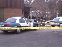 Police cars surround a Wachovia bank branch in Raleigh Dec. 30, 2010.