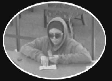 Surveillance images show the woman suspected of robbing a Raleigh bank on Dec. 30, 2010.