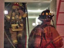 Firefighters respond to an apartment at the Arbor Creek complex off Buck Jones Road on Thursday, Jan. 6, 2010.