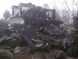 Fire destroyed this home at 5705 Carriage Park, off Sunset Lake Road.