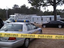 Hoke County and state authorities investigate a suspected methamphetamine lab east of Raeford on Feb. 3, 2011. A 4-month-old boy suffering from chemical burns was found inside the mobile home.