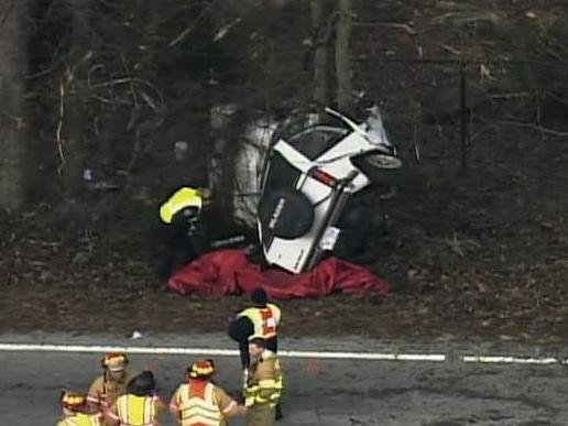 Troopers investigate a fatal crash on Lake Wheeler Road near Penny Road in Raleigh, Feb. 7, 2011.