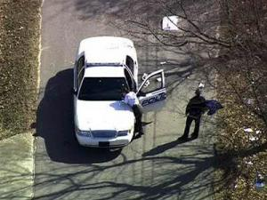 Oxford police investigate the scene of an officer-involved shooting on Railroad Avenue on March 4, 2011. An officer killed a man suspected of robbing a downtown insurance agency.