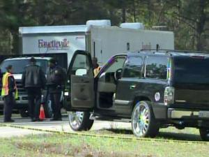 Police closed the All American Expressway from Fort Bragg south to Fayetteville Monday after a woman was shot shortly before 3 p.m.