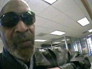 Surveillance images show the man suspected of robbing a Durham bank on April 1, 2011.