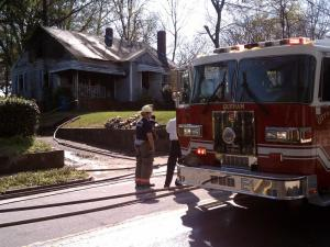 Fire crews were called to a house on East Main Street in Durham Sunday afternoon to battle flames that left the exterior charred, authorities said.