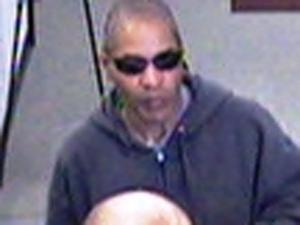 Surveillance images show the man suspected of robbing a Durham bank on April 4, 2011.