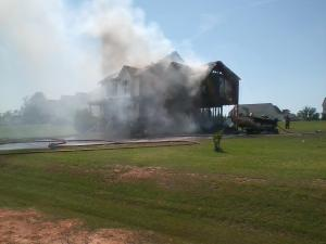 A Garner family of four was displaced Saturday when a fire erupted in the family's garage and spread to fully engulf the house.