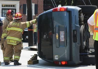An SUV flipped on its side in a single-car wreck Tuesday at the corner of Rosemary and Henderson streets in Chapel Hill, police said. Photo courtesy of Daily Tar Heel photographer Erin Hull.