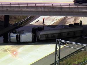 An overturned tractor-trailer blocked eastbound lanes on the U.S. Highway 64 Bypass near Knightdale on June 6, 2011.