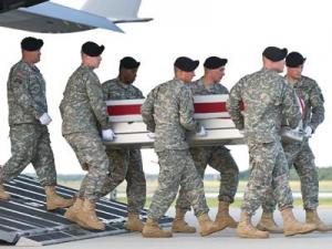 A U.S. Army carry team transfers the remains of Army Sgt. Jeffrey C. S. Sherer, of Four Oaks, N.C., at Dover Air Force Base, Del., June 5, 2011. Sherer was assigned to the 1st Battalion, 24th Infantry Regiment, 1st Brigade Combat Team, 25th Infantry Division, Fort Wainwright, Alaska. (U.S. Air Force photo/Roland Balik)