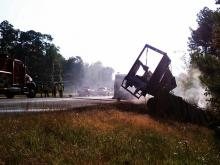 A tractor-trailer caught fire along U.S. 64 East, near N.C. Highway 751, just inside the Chatham-Wake county line, around 5:45 a.m., Chatham County emergency dispatchers said.
