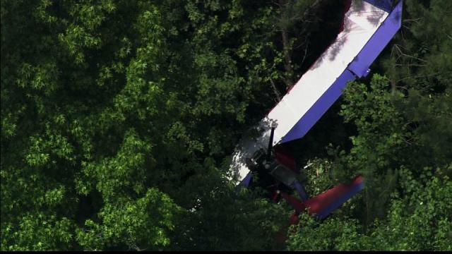 An ultralight plane landed in a tree in Moore County Monday. The pilot walked away.