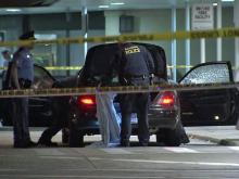 Raleigh police examine a car at Raleigh-Durham International Airport on Wednesday, June 22, 2011. Shooters opened fired on at the car along Interstate 540, near Glenwood Avenue in Raleigh, shortly before 11 p.m. The man and woman inside were not injured.