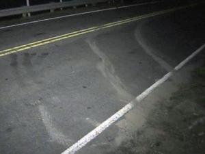 Skid marks along Buffalo Lake Road in Sanford where one person was killed after a chase with authorities on June 29, 2011.