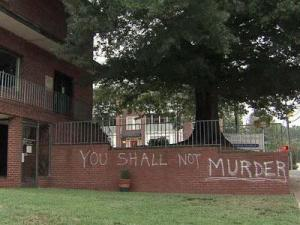"""The words """"You Shall Not Murder"""" and """"Baby Murder"""" were sprayed in white paint on the brick wall around the Planned Parenthood building at 100 S. Boylan Ave. in Raleigh on July 12, 2011."""
