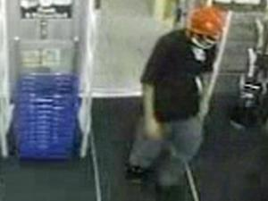 Clayton police released photos from surveillance cameras of two masked men, one carrying a rifle, who robbed a Walgreens store, at 11306 U.S. Highway 70 West, around 12:30 a.m. on July 28, 2011.