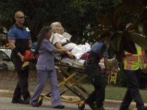A patient at Cary Health and Rehab Center on Tryon Road is taken by paramedics to the hospital after fire breaks out at the facility on July 30, 2011.