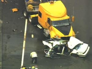 A tractor-trailer and a car collided at Exit 77 to Hodges Chapel Road in Harnett County on Friday, Aug. 5, 2011.