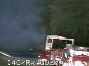 An activity bus fire temporarily closed the exit ramp from Rock Quarry Road to Interstate 40 West around 6:30 a.m. Thursday, Aug. 11, 2011.