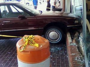 A car crashed through the front of a state DMV driver's license office in Fayetteville on Sept. 7, 2011.