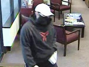 A man wearing a black bandanna over his face entered the BB&T branch at 2726 Croasdaile Drive in Durham on Sept. 16, 2011, and demanded money, police said.