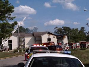 Emergency crews respond to an apartment fire at 522 Northumberland St. in Fayetteville Friday, Sept. 30, 2011.