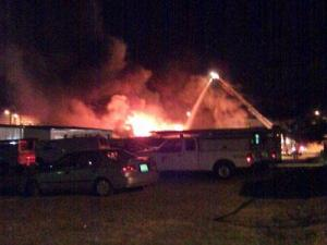 Crews fight a fire at Schooly's Bar and Billiards in Sanford on Oct. 6, 2011. (Submitted by Michael Tatum)